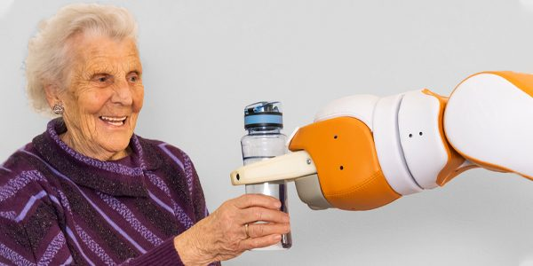 Robot Lio handles the water to an elderly woman